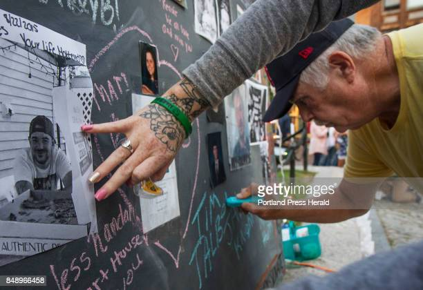Tim Talbot Sr of Portland writes on the memory board in honor of his son Timothy Jr during an Overdose Awareness vigil at Monument Square in Portland...