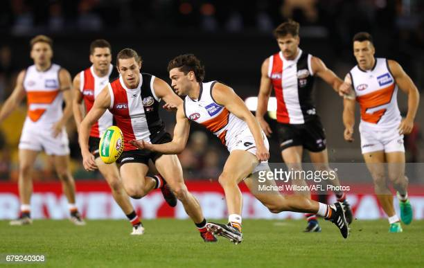 Tim Taranto of the Giants and Jack Steele of the Saints compete for the ball during the 2017 AFL round 07 match between the St Kilda Saints and the...