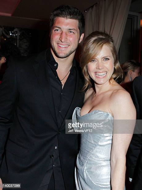 Tim Tebow and actress Amy Adams attend the 2012 Vanity Fair Oscar Party Hosted By Graydon Carter at Sunset Tower on February 26 2012 in West...