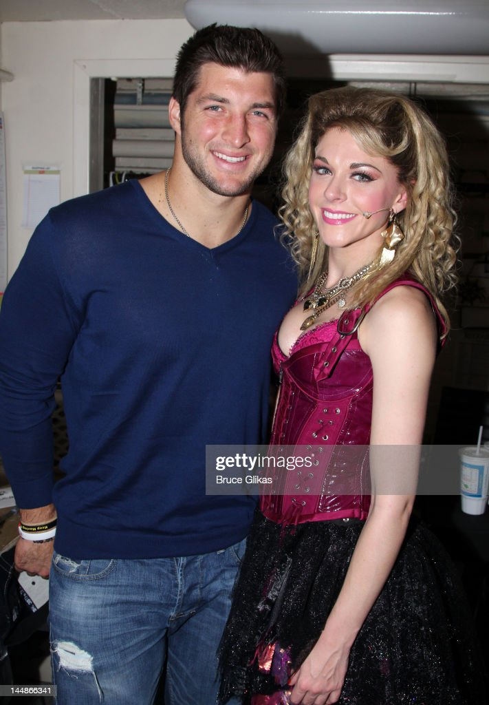 Tim Tebow and Ashley Spencer pose backstage at the hit rock musical 'Rock of Ages' on Broadway at The Helen Hayes Theater on May 19 2012 in New York...