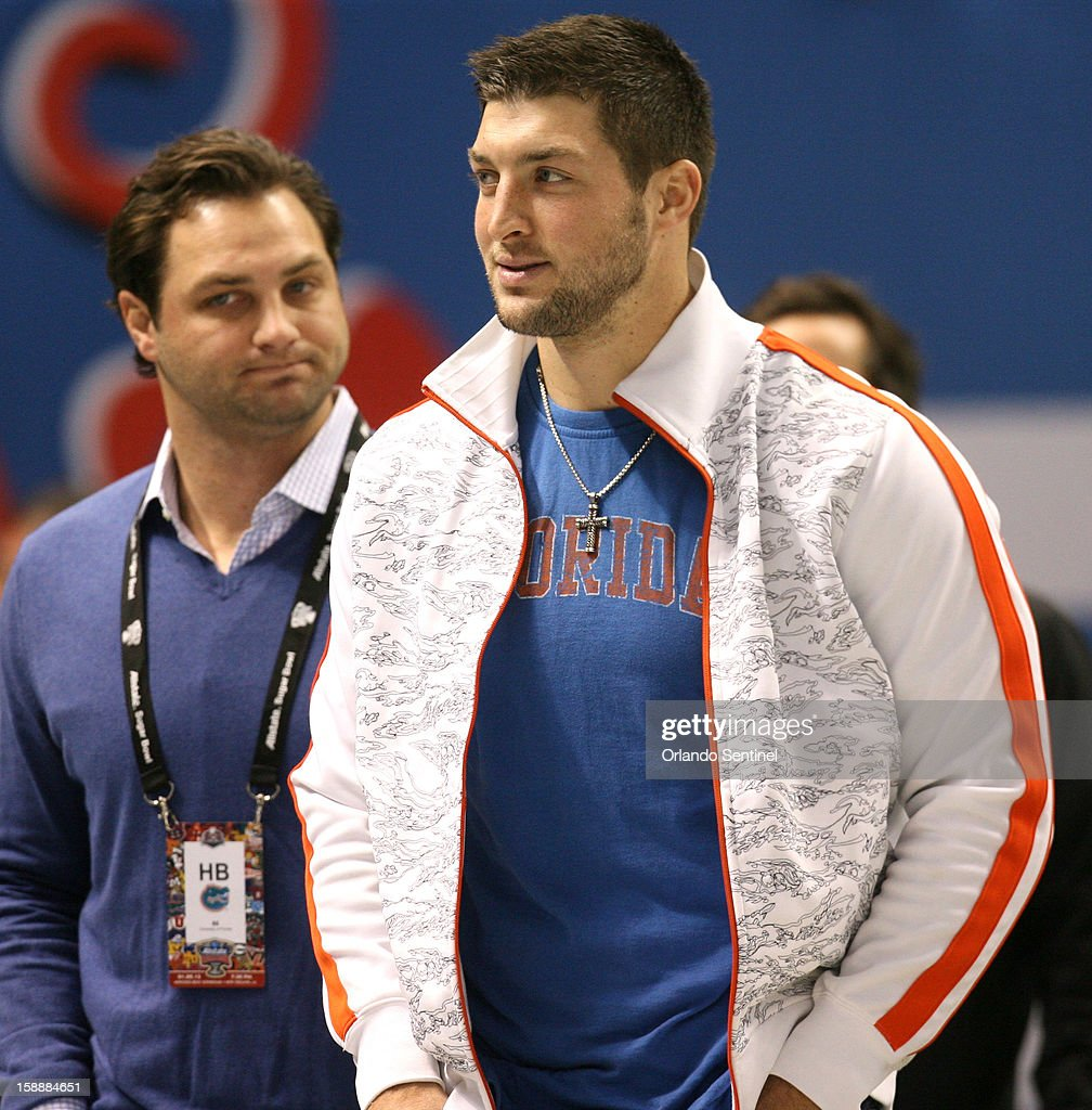 Tim Tebow, former quarterback of the Florida Gators, stands on the sidelines before the start of the Allstate Sugar Bowl game between Florida and the Louisville Cardinals at the Mercedes-Benz Superdome on Wednesday, January 2, 2013, in New Orleans, Louisiana.