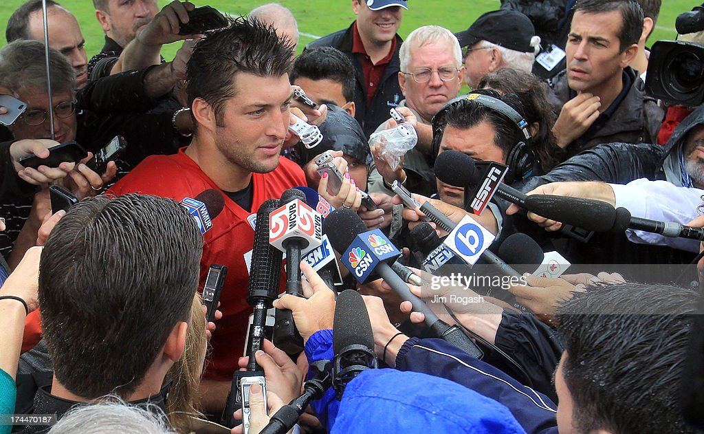 Tim Tebow #5 interacts with the media after the first day of New England Patriots Training Camp at Gillette Stadium on July 26, 2013 in Foxboro, Massachusetts.
