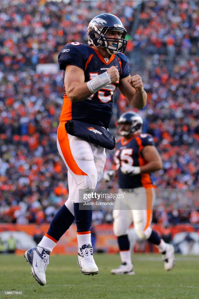 <a gi-track='captionPersonalityLinkClicked' href=/galleries/search?phrase=Tim+Tebow&family=editorial&specificpeople=2729658 ng-click='$event.stopPropagation()'>Tim Tebow</a> #15 of the Denver Broncos celebrates after running the ball in the end zone for a touchdown in the second quarter against the Pittsburgh Steelers during the AFC Wild Card Playoff game at Sports Authority Field at Mile High on January 8, 2012 in Denver, Colorado.