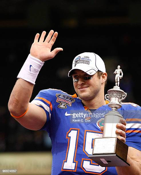 Tim Tebow of the Florida Gators hoist a trophy after defeating the Cincinnati Bearcats 2451 in the Allstate Sugar Bowl at the Louisana Superdome on...