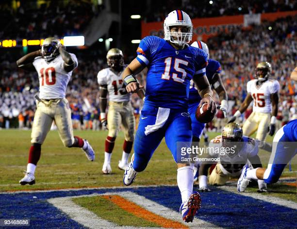 Tim Tebow of the Florida Gators runs for a touchdown during the game against the Florida State Seminoles at Ben Hill Griffin Stadium on November 28...
