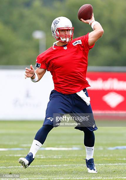 Tim Tebow of the New England Patriots practices during minicamp at Gillette Stadium on June 11 2013 in Foxboro Massachusetts