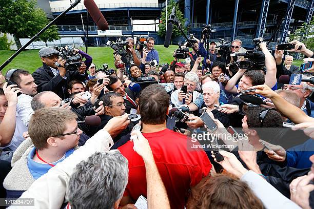 Tim Tebow of the New England Patriots talks to reporters following minicamp at Gillette Stadium on June 11 2013 in Foxboro Massachusetts