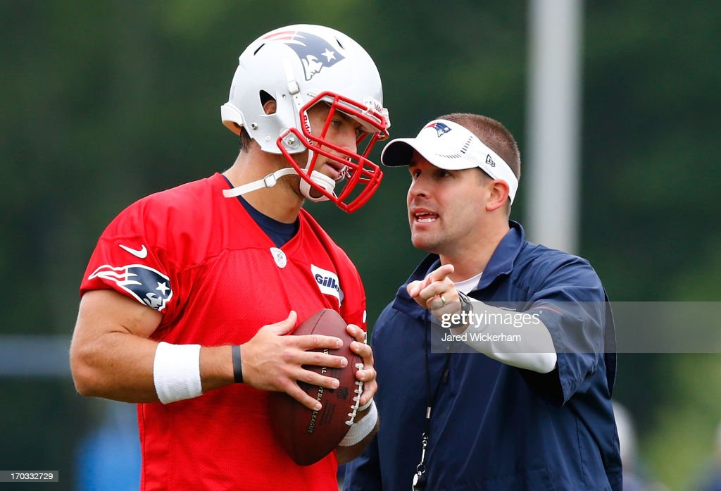 <a gi-track='captionPersonalityLinkClicked' href=/galleries/search?phrase=Tim+Tebow&family=editorial&specificpeople=2729658 ng-click='$event.stopPropagation()'>Tim Tebow</a> #5 (L) of the New England Patriots talks with offensive coordinator and quarterbacks coach <a gi-track='captionPersonalityLinkClicked' href=/galleries/search?phrase=Josh+McDaniels&family=editorial&specificpeople=749107 ng-click='$event.stopPropagation()'>Josh McDaniels</a> during minicamp at Gillette Stadium on June 11, 2013 in Foxboro, Massachusetts.