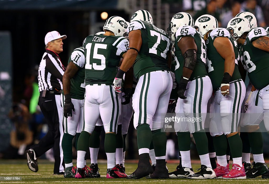 <a gi-track='captionPersonalityLinkClicked' href=/galleries/search?phrase=Tim+Tebow&family=editorial&specificpeople=2729658 ng-click='$event.stopPropagation()'>Tim Tebow</a> #15 of the New York Jets calls a play in the huddle against the Houston Texans at MetLife Stadium on October 8, 2012 in East Rutherford, New Jersey.