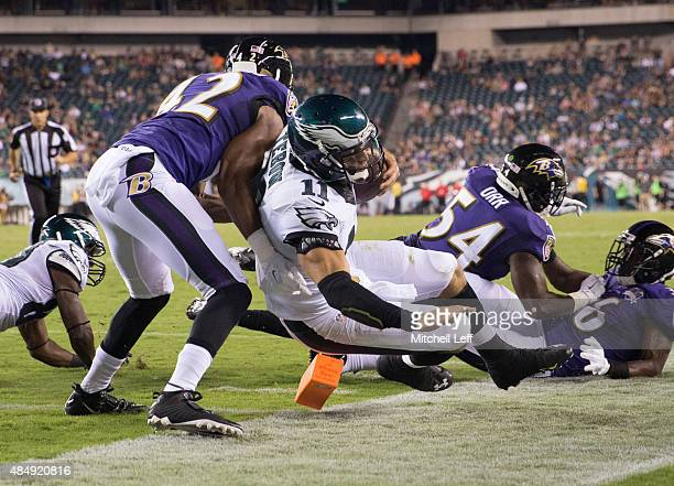 Tim Tebow of the Philadelphia Eagles is stopped short of the endzone by Chris Greenwood of the Baltimore Ravens in the fourth quarter on August 22...