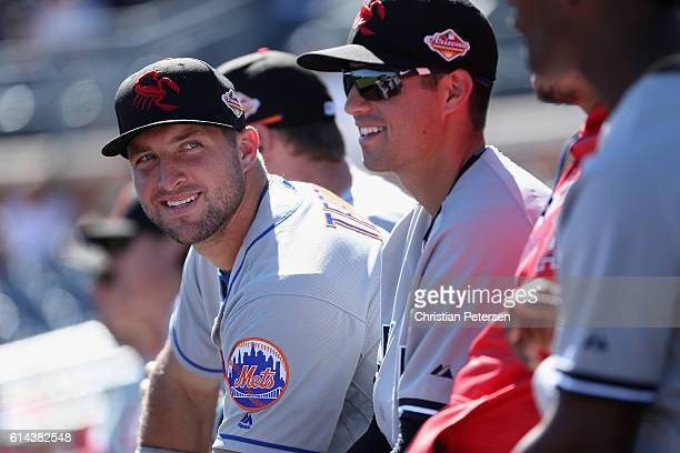 Tim Tebow of the Scottsdale Scorpions watches from the dugout during the Arizona Fall League game against the Peoria Javelinas at Peoria Stadium on...