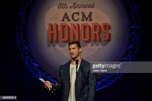 Tim Tebow presents at the 8th Annual ACM Honors at the Ryman Auditorium on September 9 2014 in Nashville Tennessee