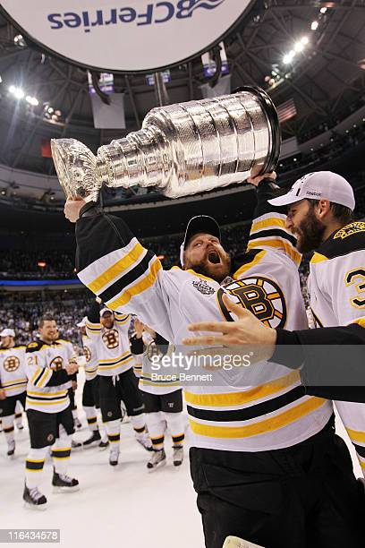 Tim Thomas and Patrice Bergeron of the Boston Bruins celebrate with the Stanley Cup after defeating the Vancouver Canucks in Game Seven of the 2011...