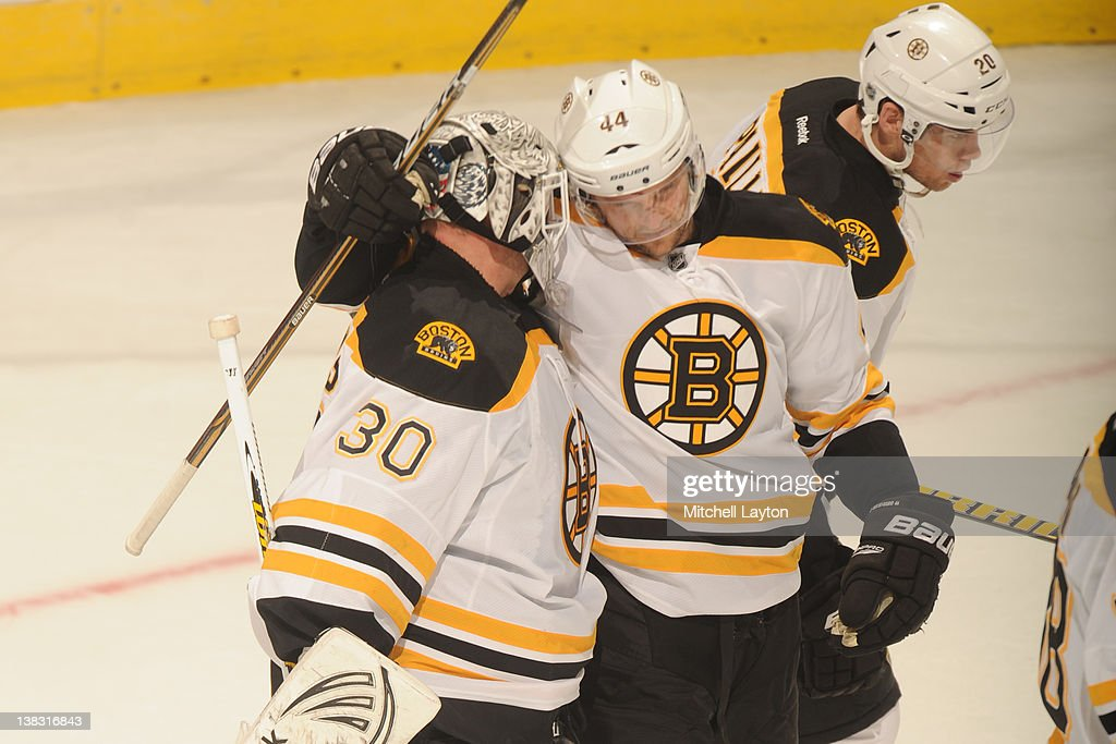 Tim Thomas #30 and <a gi-track='captionPersonalityLinkClicked' href=/galleries/search?phrase=Dennis+Seidenberg&family=editorial&specificpeople=204616 ng-click='$event.stopPropagation()'>Dennis Seidenberg</a> #44 of the Boston Bruins and celebrate a win after an NHL hockey game against the Washington Capitals on February 5, 2012 at the Verizon Center in Washington, DC.