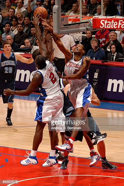 Tim Thomas and Marcus Camby of the Los Angeles Clippers rise for a block against the Utah Jazz at Staples Center on November 3 2008 in Los Angeles...