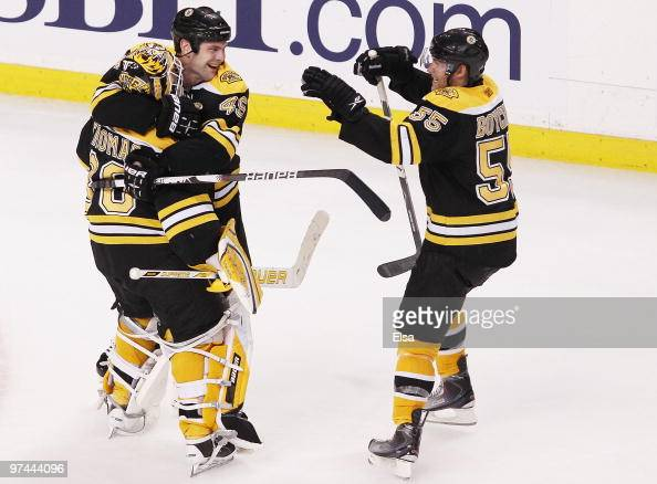 Tim Thomas and Mark Stuart and Johnny Boychuk of the Boston Bruins celebrate the win over the Toronto Maple Leafs on March 4 2010 at the TD Garden in...