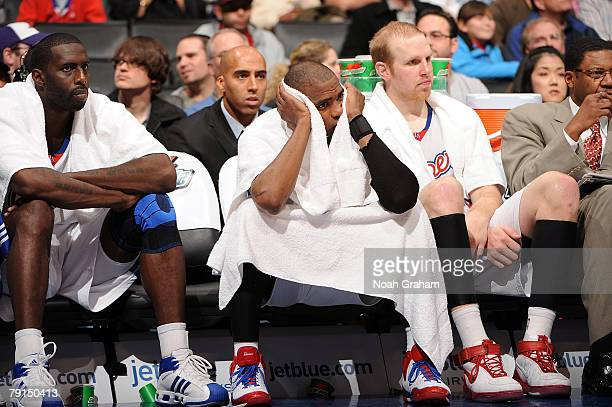Tim Thomas Cuttino Mobley and Chris Kaman of the Los Angeles Clippers watch from the bench during their 10993 loss to the Utah Jazz at Staples Center...
