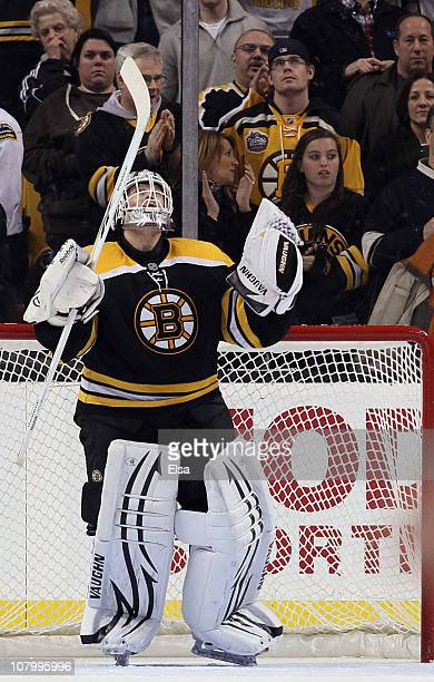 Tim Thomas of the Boston Bruins celebrates after he shut out the Ottawa Senators on January 11 2011 at the TD Garden in Boston Massachusetts The...