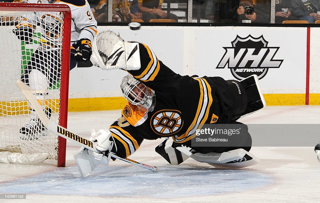 Tim Thomas #30 of the Boston Bruins dives to make a save against the Buffalo Sabres at the TD Garden on April 7, 2012 in Boston, Massachusetts.