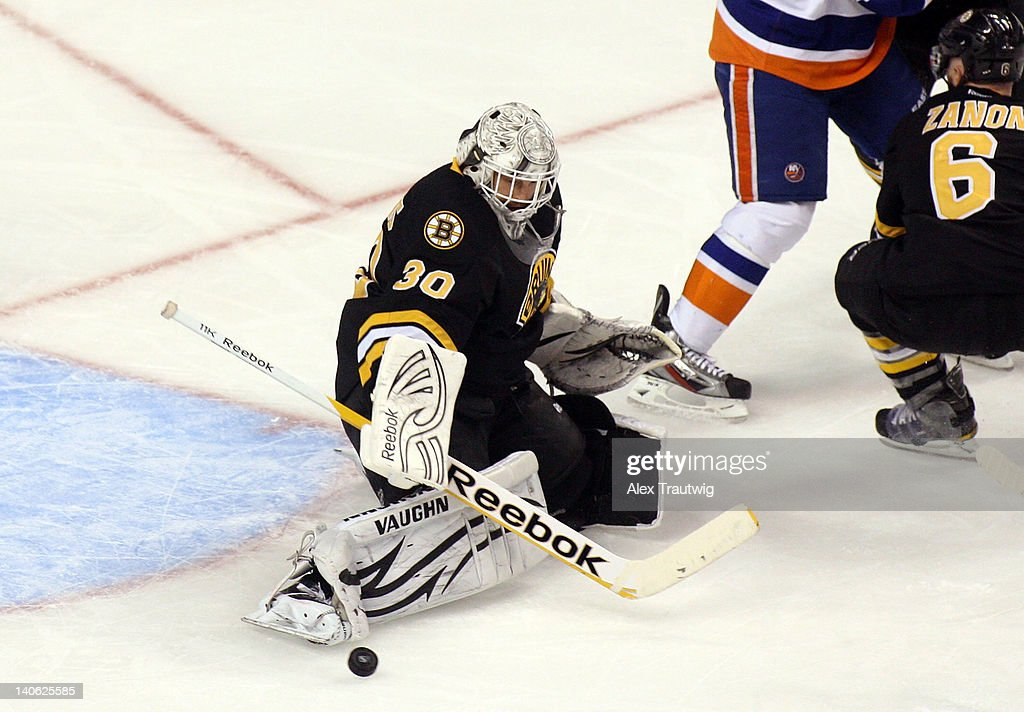 Tim Thomas #30 of the Boston Bruins makes a save against the New York Islanders at TD Garden on March 3, 2012 in Boston, Massachusetts. The Islanders defeated the Bruins 3-2.