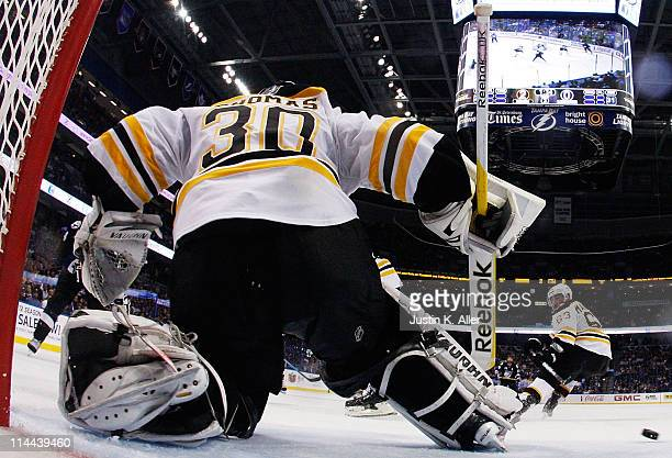 Tim Thomas of the Boston Bruins makes a save against the Tampa Bay Lightning in Game Three of the Eastern Conference Finals during the 2011 NHL...