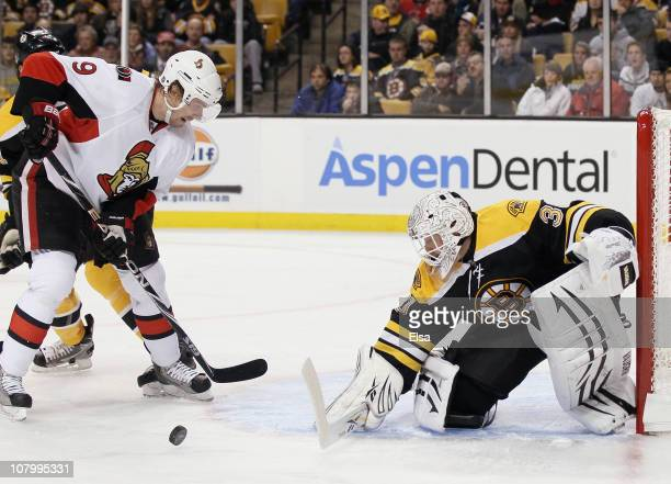 Tim Thomas of the Boston Bruins stops a shot by Milan Michalek of the Ottawa Senators on January 11 2011 at the TD Garden in Boston Massachusetts