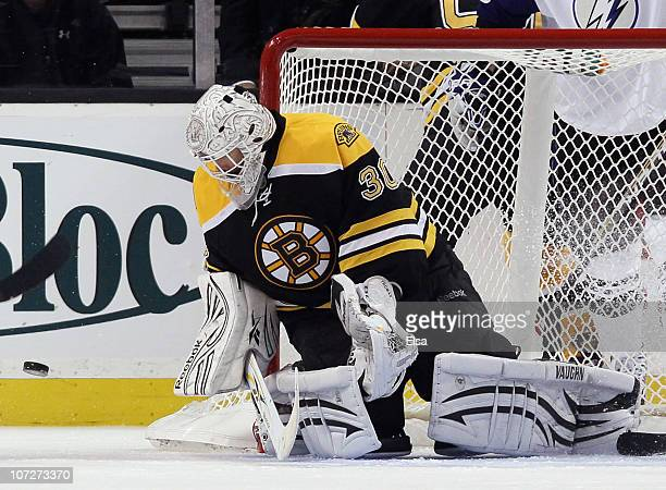 Tim Thomas of the Boston Bruins stops a shot in the third period against the Tampa Bay Lightning on December 2 2010 at the TD Garden in Boston...