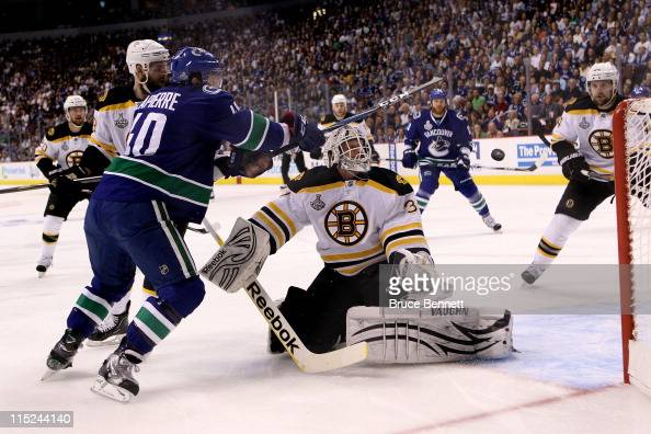 Tim Thomas of the Boston Bruins tends goal against Maxim Lapierre of the Vancouver Canucks during Game Two of the 2011 NHL Stanley Cup Final at...