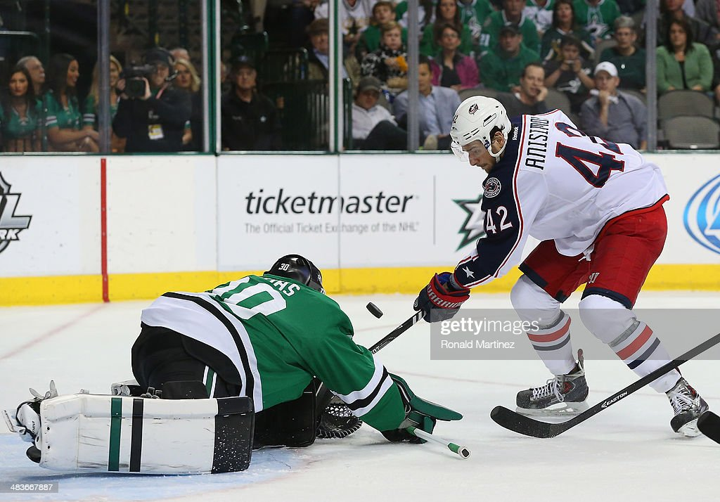 Tim Thomas #30 of the Dallas Stars makes a save against Artem Anisimov #42 of the Columbus Blue Jackets in the second period at American Airlines Center on April 9, 2014 in Dallas, Texas.