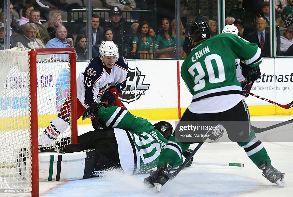 Tim Thomas #30 of the Dallas Stars makes a save against Cam Atkinson #13 of the Columbus Blue Jackets in the second period at American Airlines Center on April 9, 2014 in Dallas, Texas.