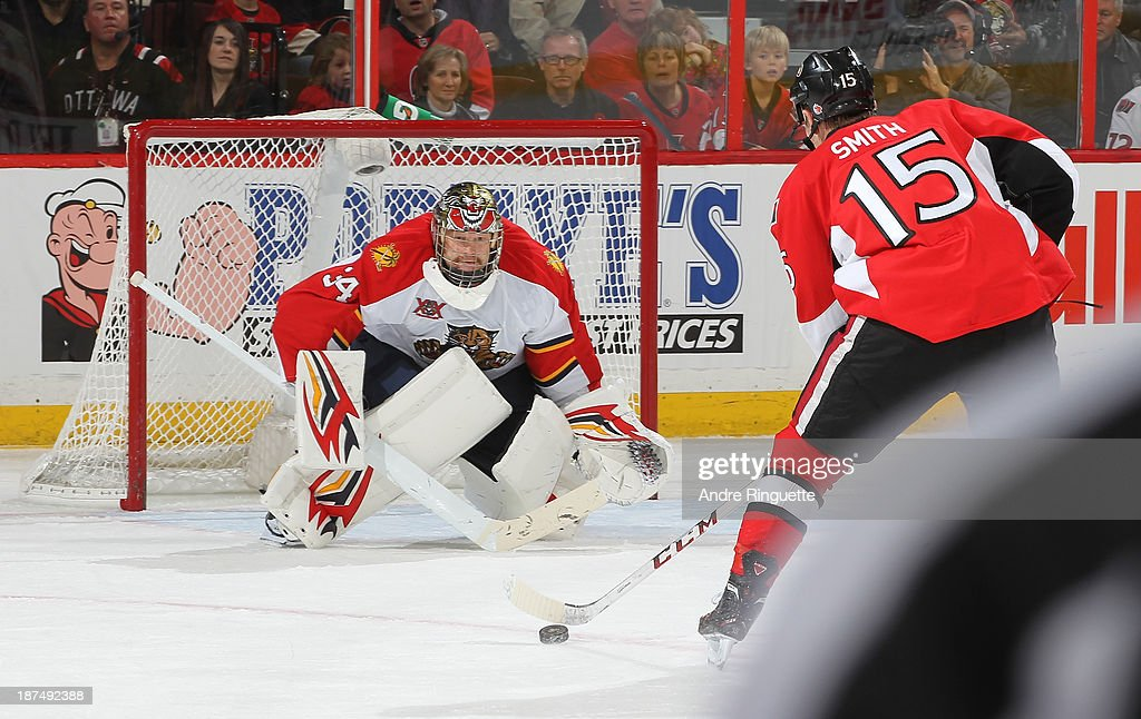 Tim Thomas #34 of the Florida Panthers guards his net against a shorthanded breakaway attempt by Zack Smith #15 of the Ottawa Senators at Canadian Tire Centre on November 9, 2013 in Ottawa, Ontario, Canada.