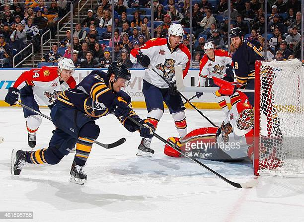 Tim Thomas of the Florida Panthers makes a diving third period save against Johan Larsson of the Buffalo Sabres on January 9 2014 at the First...