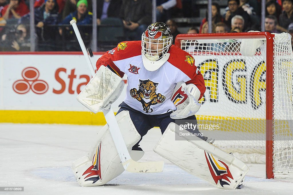 Tim Thomas #34 of the Florida Panthers makes a save against the Calgary Flames during an NHL game at Scotiabank Saddledome on November 22, 2013 in Calgary, Alberta, Canada. The Flames defeated the Panthers 4-3 in shootout.