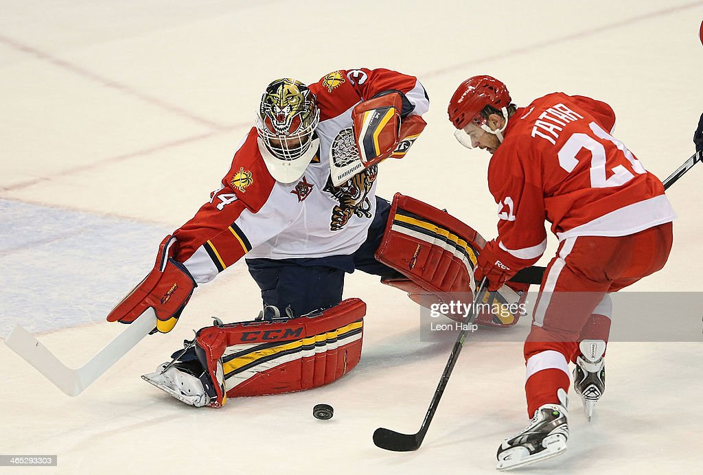 Tim Thomas #34 of the Florida Panthers makes the save on <a gi-track='captionPersonalityLinkClicked' href=/galleries/search?phrase=Tomas+Tatar&family=editorial&specificpeople=5652303 ng-click='$event.stopPropagation()'>Tomas Tatar</a> #21 of the Detroit Red Wings during the third period of the game at Joe Louis Arena on January 26, 2014 in Detroit, Michigan. The Panthers defeated the Wings 5-4 in a shootout