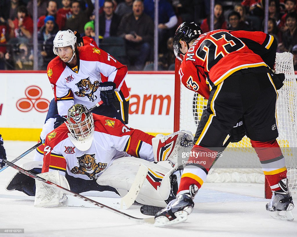 Tim Thomas #34 of the Florida Panthers stops the shot of Sean Monahan #23 of the Calgary Flames during an NHL game at Scotiabank Saddledome on November 22, 2013 in Calgary, Alberta, Canada. The Flames defeated the Panthers 4-3 in shootout.