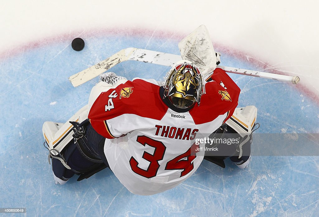Tim Thomas #34 of the Florida Panthers warms up for the NHL game against the Vancouver Canucks at Rogers Arena on November 19, 2013 in Vancouver, British Columbia, Canada.