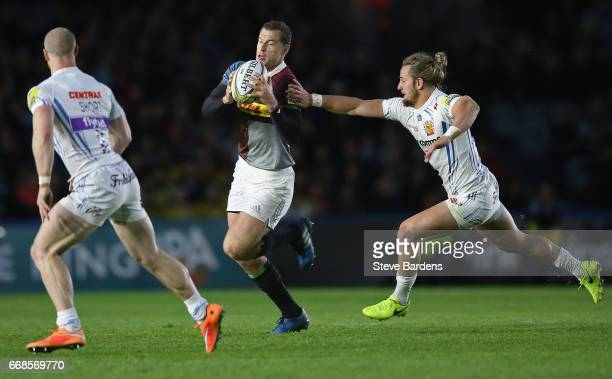 Tim Visser of Harlequins breaks away from Michele Campagnaro of Exeter Chiefs during the Aviva Premiership match between Harlequins and Exeter Chiefs...