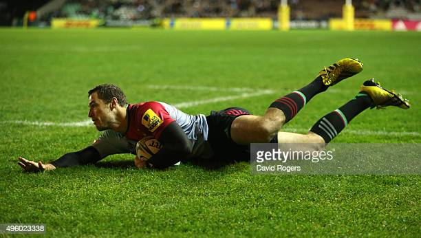 Tim Visser of Harlequins dives over for a try during the Aviva Premiership match between Harlequins and Sale Sharks at Twickenham Stoop on November 6...