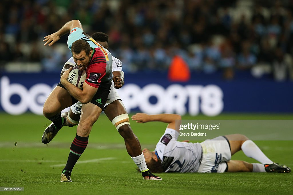 Tim Visser of Harlequins is tackled by Fulgence Ouedraogo of Montpellier during the European Rugby Challenge Cup Final match between Harlequins and...