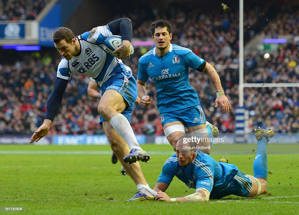 Tim Visser of Scotland breaks through the tackle of <a gi-track='captionPersonalityLinkClicked' href=/galleries/search?phrase=Sergio+Parisse&family=editorial&specificpeople=648570 ng-click='$event.stopPropagation()'>Sergio Parisse</a> of Italy to score a try during the RBS Six Nations match between Scotland and Italy at Murrayfield Stadium on February 9, 2013 in Edinburgh, Scotland.