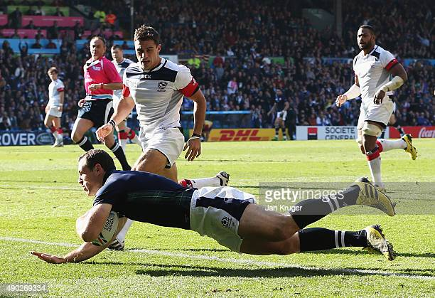 Tim Visser of Scotland scores his teams opening try during the 2015 Rugby World Cup Pool B match between Scotland and USA at Elland Road on September...