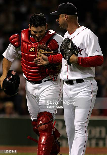 Tim Wakefield congratulates catcher Doug Mirabelli after he made three outs on catches of pop ups to end the inning
