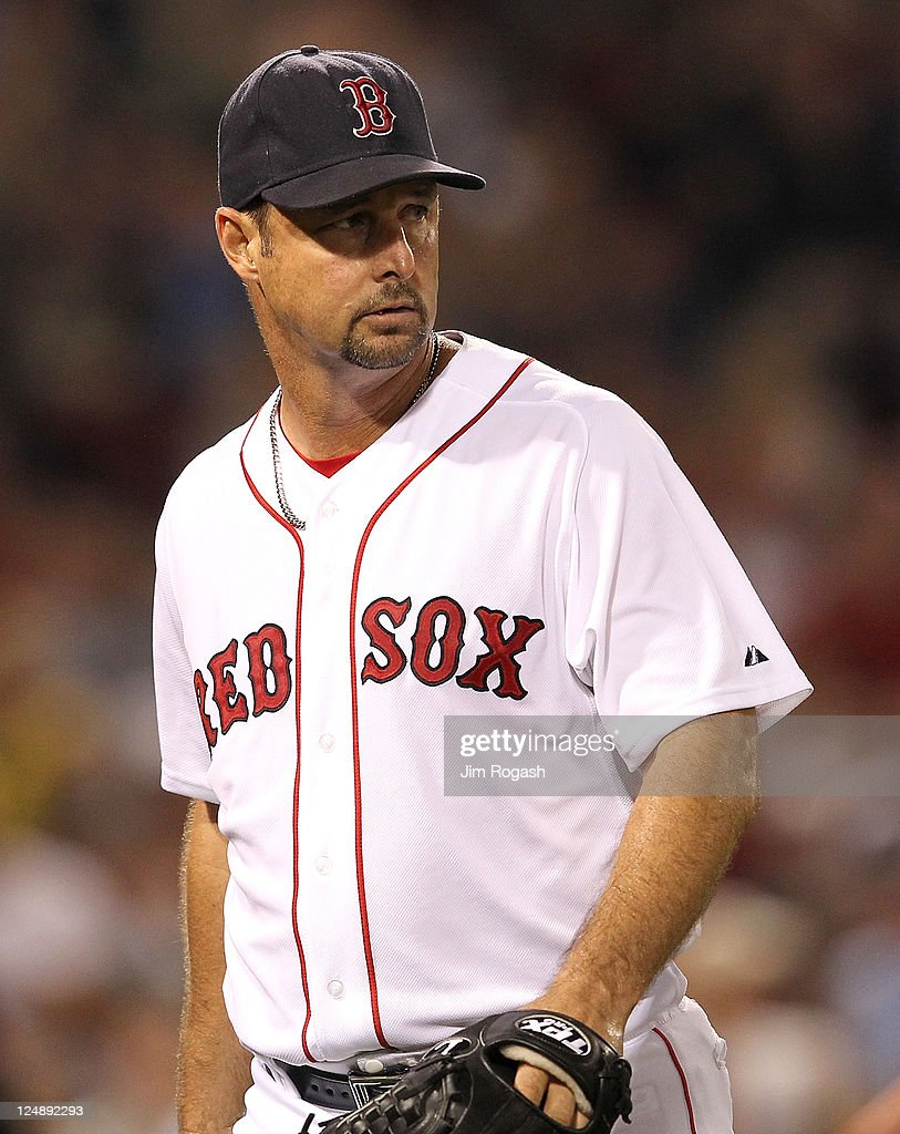 Tim Wakefield #49 of the Boston Red Sox heads for the dugout after the sixth inning against the Toronto Blue Jays, seeing his 200th win, at Fenway Park September 13, 2011 in Boston, Massachusetts.