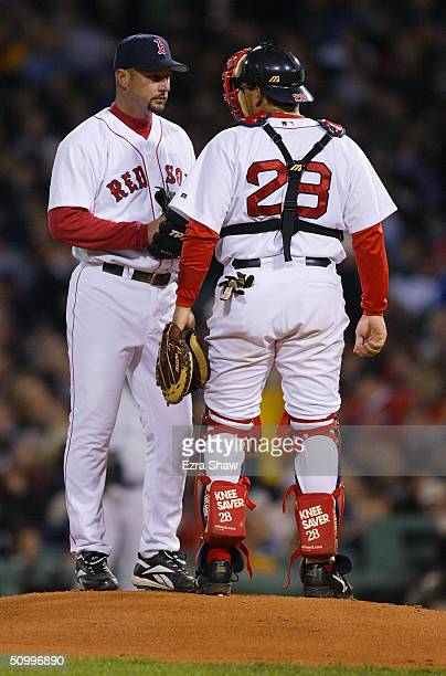 Tim Wakefield of the Boston Red Sox listens to teammmate catcher Doug Mirabelli on the mound during the game against the New York Yankees on April 16...