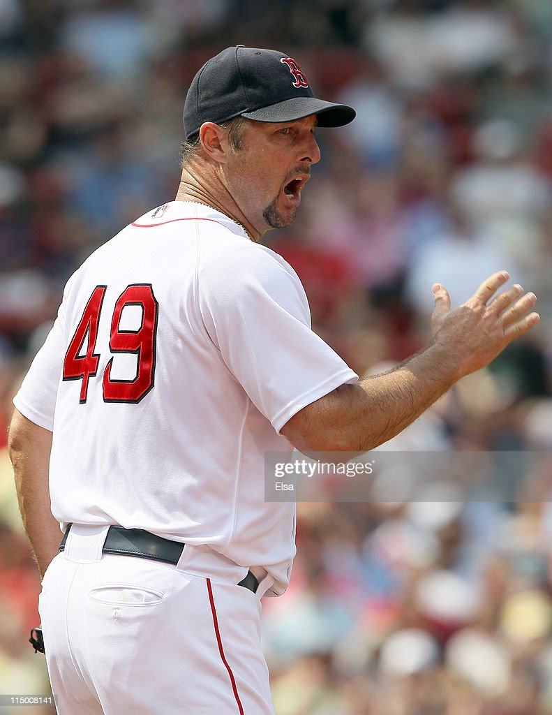 <a gi-track='captionPersonalityLinkClicked' href=/galleries/search?phrase=Tim+Wakefield&family=editorial&specificpeople=171949 ng-click='$event.stopPropagation()'>Tim Wakefield</a> #49 of the Boston Red Sox reacts after Juan Pierre of the Chicago White Sox is called safe after a rundown on June 1, 2011 at Fenway Park in Boston, Massachusetts.