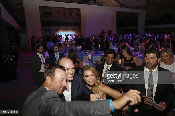 Tim Wakefield Paul Platten and Rachel Platten pose for a selfie together as Jason Varitek looks on at the UNICEF Children's Champion Award Dinner...