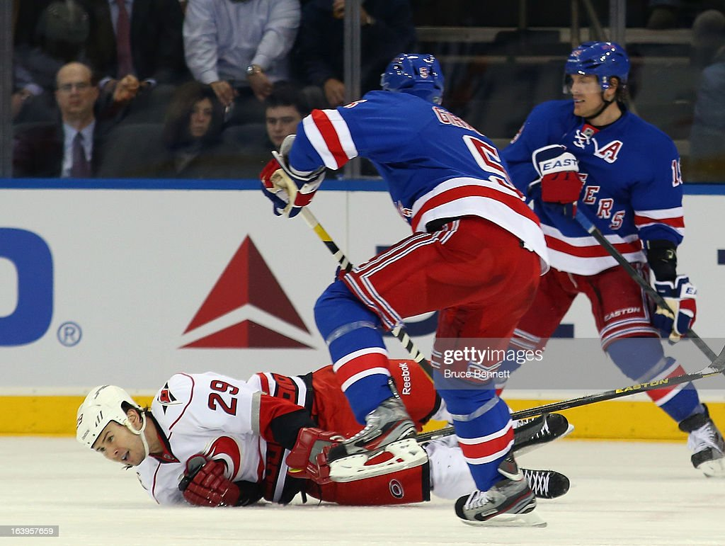 Tim Wallace #29 of the Carolina Hurricanes goes down to block a shot by Dan Girardi #5 of the New York Rangers during the first period at Madison Square Garden on March 18, 2013 in New York City.