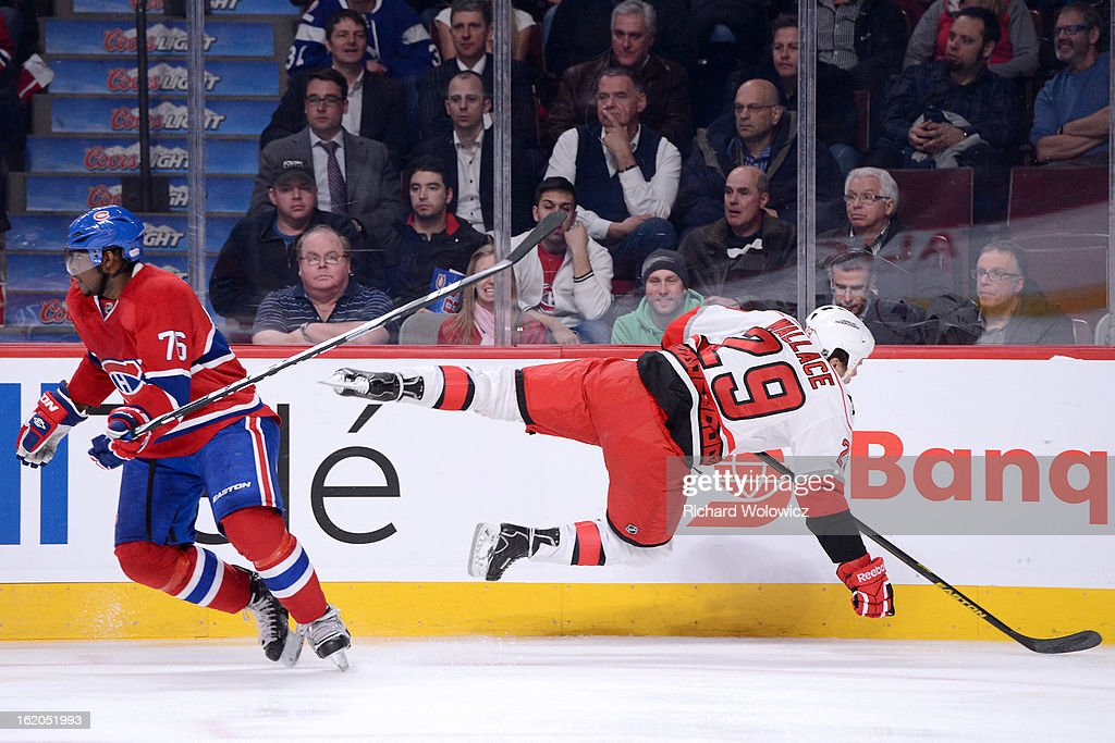 Tim Wallace #29 of the Carolina Hurricanes misses his body checks on P.K. Subban #76 of the Montreal Canadiens during the NHL game at the Bell Centre on February 18, 2013 in Montreal, Quebec, Canada.