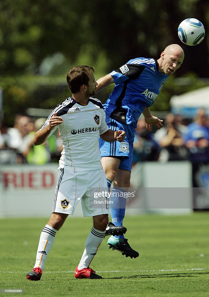 Tim Ward #20 of the San Jose Earthquakes heads the ball away from Mike Magee #18 of the Los Angeles Galaxy on August 21, 2010 at Buck Shaw Stadium in Santa Clara, California. The Earthquakes won 1-0.