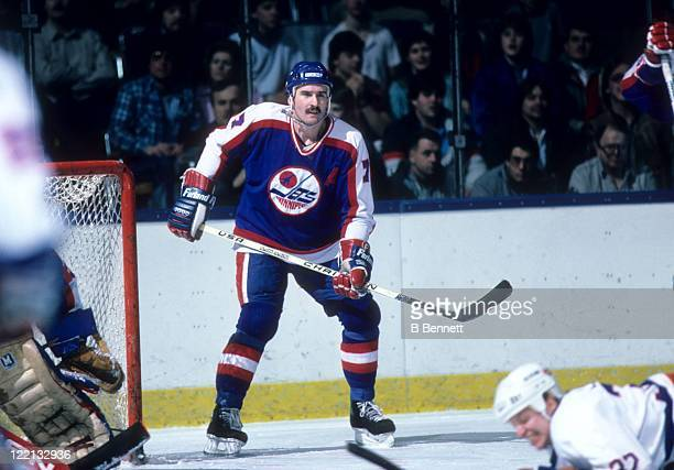 Tim Watters of the Winnipeg Jets defends the net during an NHL game against the New York Islanders on January 27 1987 at the Nassau Coliseum in...
